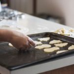 cookie-dough-cut-in-shapes-and-laid-on-baking-sheet