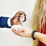 man-handing-keys-to-house-buyer